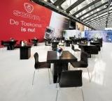 BedrijfsAutoRAI 2012 - Foto 3 - Zwarte eettafel met leren stoelen - Scania stand